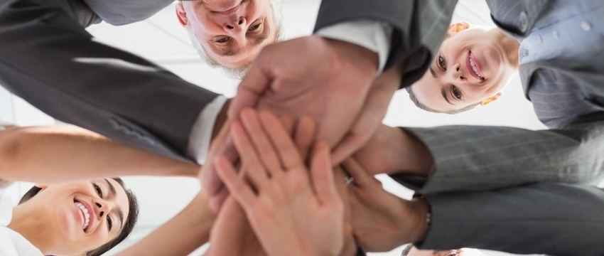 Business team standing hands together in the office-341529-edited.jpeg
