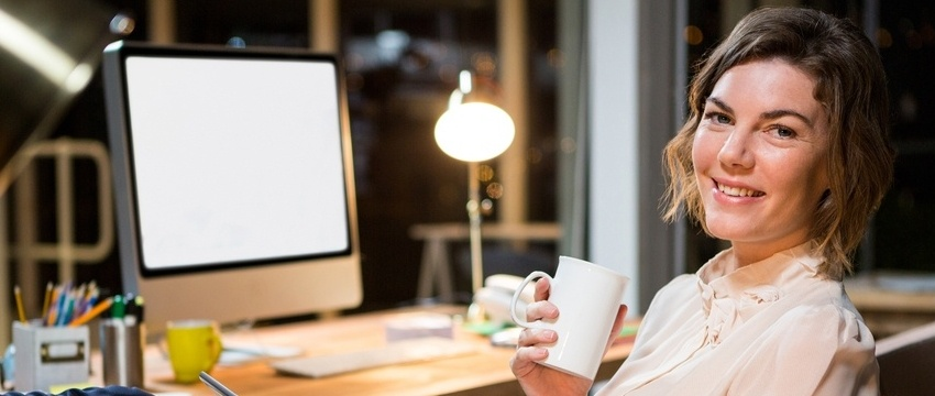 Portrait of businesswoman holding digital tablet and coffee cup at her desk in the office-595850-edited.jpeg